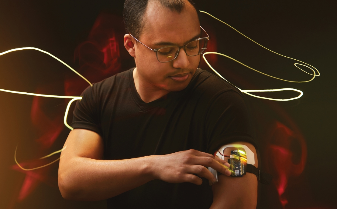 A man wearing wearable tech on his arm
