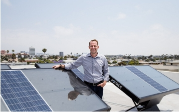 Man standing with solar panels